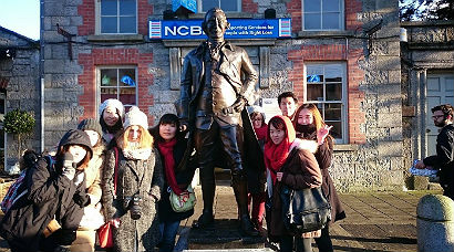 Tourists with statue of Arthur Guinness in Celbridge